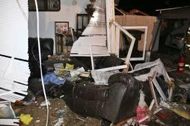 SUV-Crashes-Into-Home